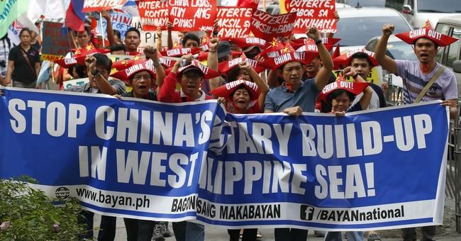 Duterte warns he'll order navy to fire if sea wealth taken