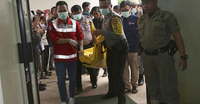 Indonesia bus crash kills 27; police say brakes failed
