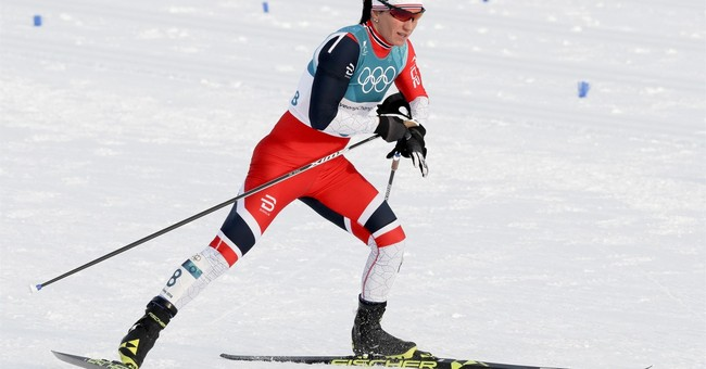 Kalla wins, Bjoergen makes history at Winter Olympics