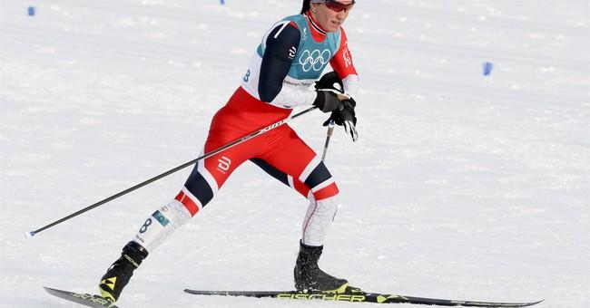 Kalla wins, Bjoergen makes history at Winter Olympics