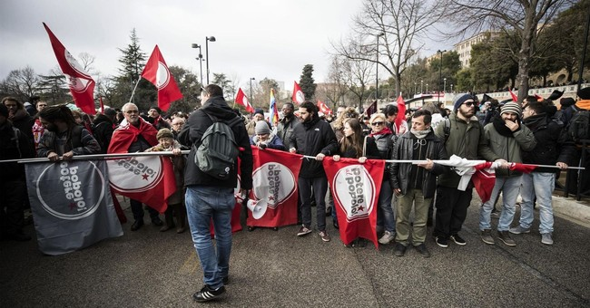 Marchers protest racism in Italy after Africans are shot