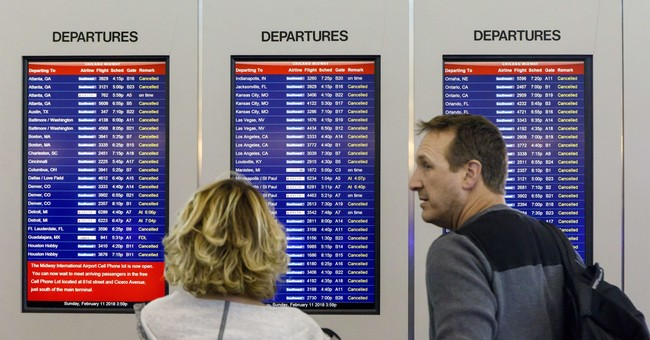 Latest Midwest snow wave delays flights, makes driving tough