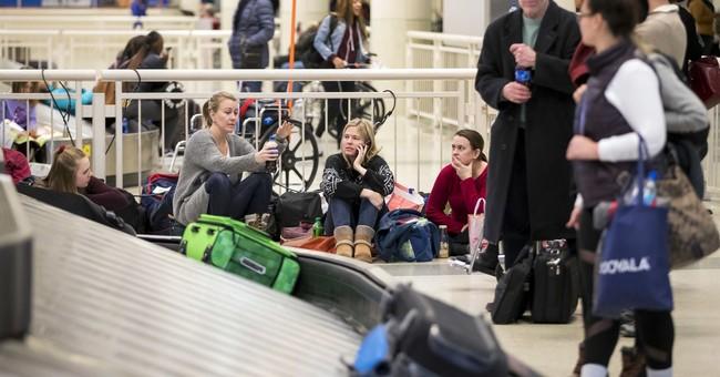 Latest Midwest snow wave delays flights, makes driving tough