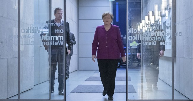 Merkel defends coalition deal against critical party members