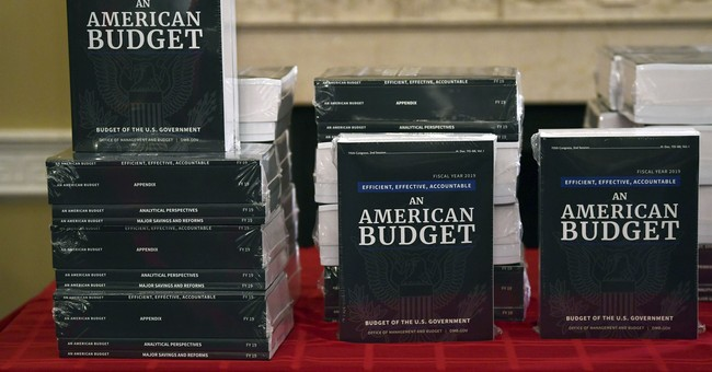The Latest: Retired generals, vets urge against US aid cuts
