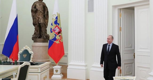 Putin meets Palestinian leader, conveys greetings from Trump