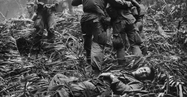 Burnished in history: How an AP photo showed the cost of war