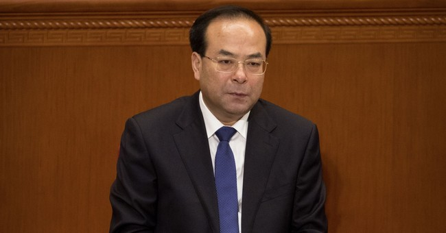 China charges former rising political star with bribery