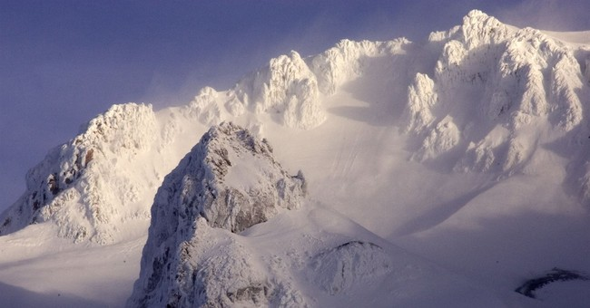The Latest: All stranded climbers safely down Mount Hood
