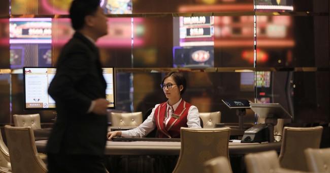 MGM opens Macau casino resort as license renewal looms