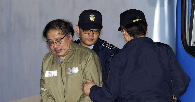 The Latest: Lotte chairman sentenced to prison for bribery