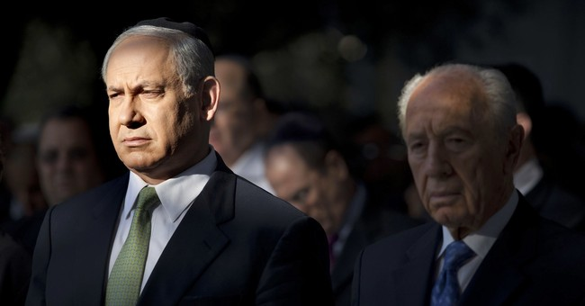 Israeli leader vows to carry on despite corruption charges