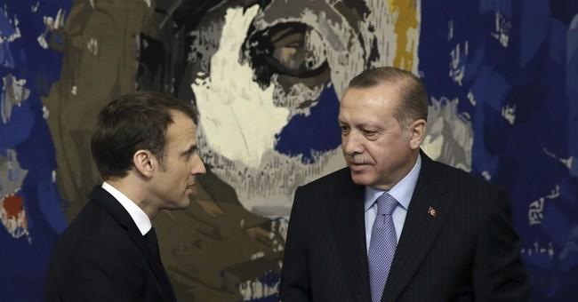 The Latest: In Paris, Erdogan calls Turkey a 'state of law'
