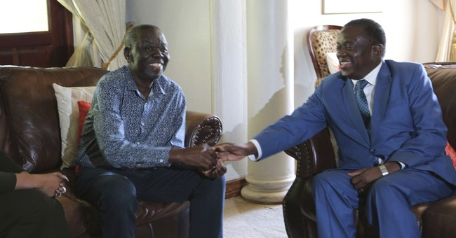 Zimbabwe leader meets opposition but rules out sharing power