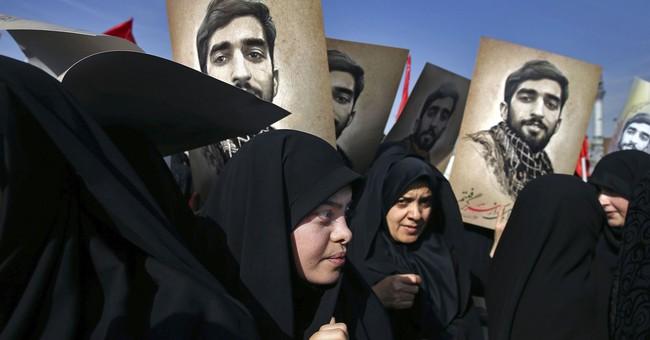 Protests put spotlight on Iran's vast, shadowy Syria war