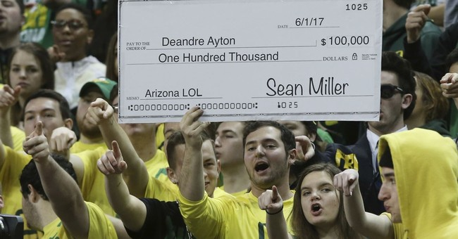With hoops under federal probe, fans say business as usual