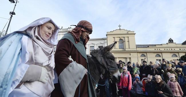 AP PHOTOS: World celebrates Epiphany with icy dips, parades