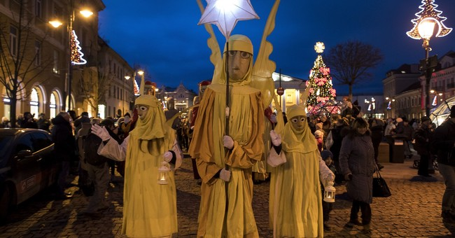 AP PHOTOS: World celebrates Epiphany with icy dips, parades