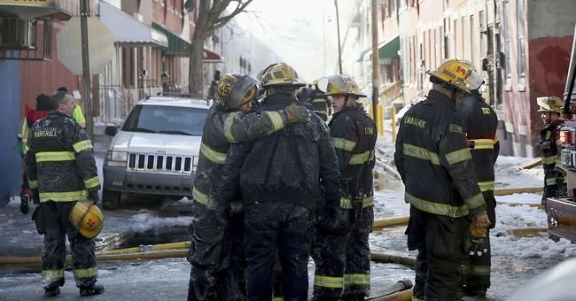 Firefighter, resident killed in Philadelphia row home fire