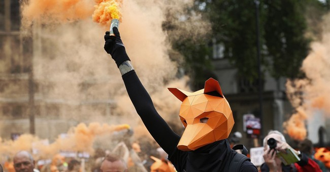 Britain scraps plan for vote on lifting fox hunting ban