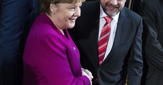 Germany's Merkel embarks on new talks to form government