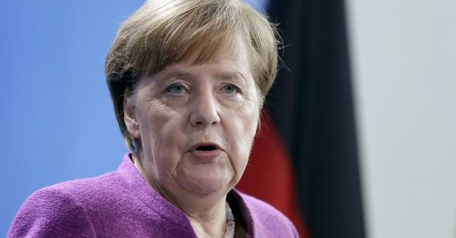 Merkel defends Germany's trade surplus as US trade war looms