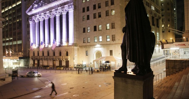 Wall Street edges up buoyed by energy; Facebook slide continues