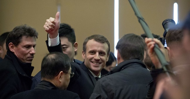 Macron appeals to China for partnership in climate, Africa