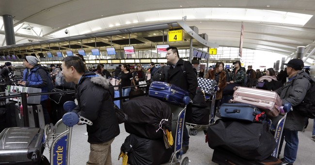 JFK airport tries to catch up, vows to probe weekend of woes