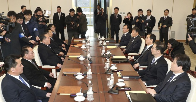 The Latest: Koreas agree to hold talks on reducing tensions