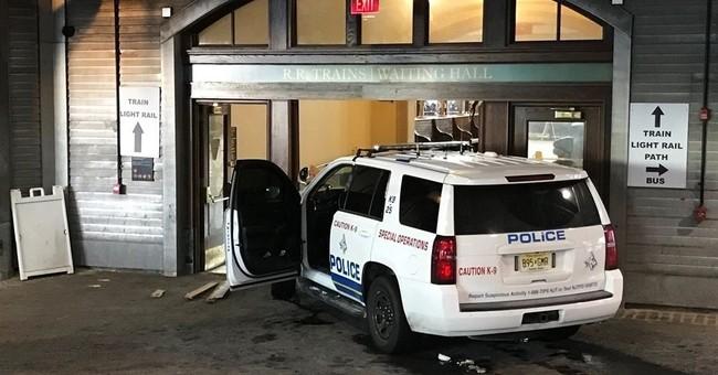 Authorities: Man drove police SUV into rail station doors