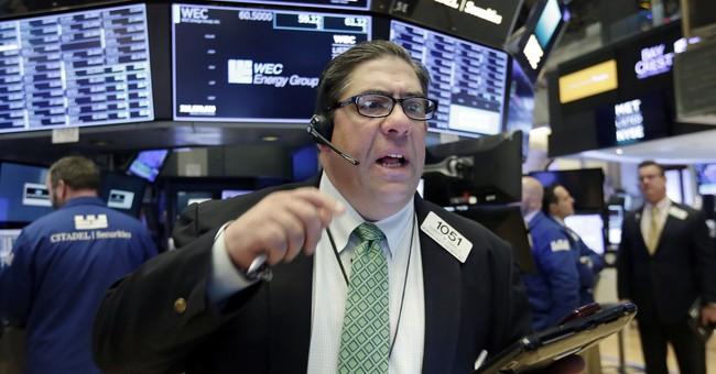 Dow Jones falls almost  350 points as tech stocks decline