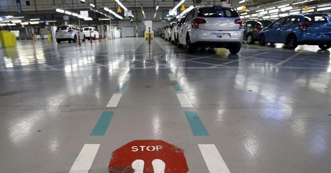 Peugeot-Citroen seeks job cuts prompted by Macron reforms