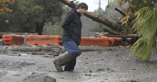 The Latest: Flooding blocks coastal California freeway