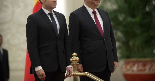 China, France promise cooperation on climate, security