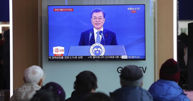 The Latest: South Korea's Moon willing to meet North's Kim