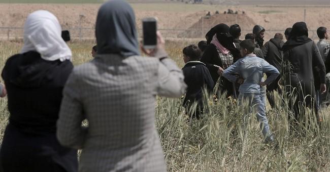Israel vows tough response to Gaza protests
