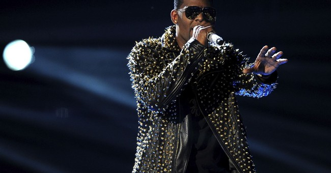 R. Kelly Charged With Multiple Counts of Sexual Abuse