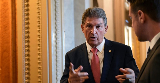Manchin Breaks Partisan Divide, Endorses Collins for Re-Election
