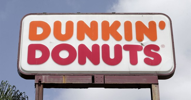 U.S. doughnut-eating champ charged with stealing from Dunkin' Donuts
