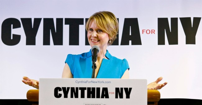 Holding a Wire Hanger, Actress Cynthia Nixon Tells Crowd About Her Mother's Illegal Abortion