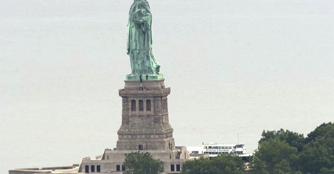 'Abolish ICE' Group Distances Self From Woman Who Scaled Statue of Liberty