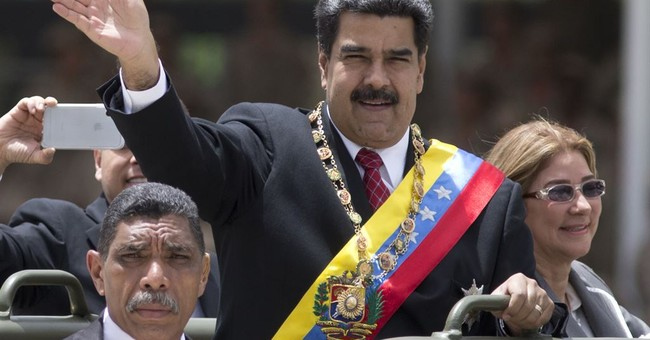 Venezuela's Nicolas Maduro's speech cut off, soldiers seen running