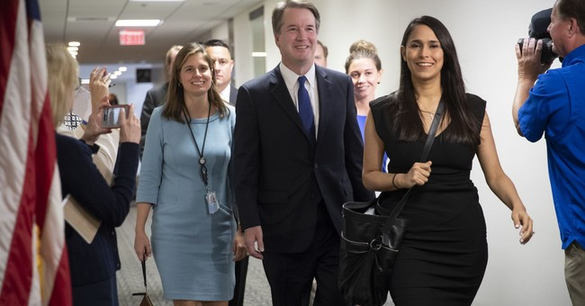 No, That Woman Behind Kavanaugh Was Not Doing A White Power Hand Signal And She's Not A Racist