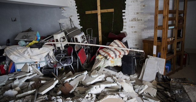 Pastors say Chinese officials are destroying crosses and burning bibles