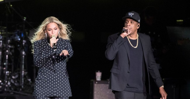 Beyonce and Jay-Z Sit During Super Bowl National Anthem