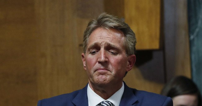 Of Course, The Two Women Who Yelled At Spineless Jeff Flake Never Had Their Political Ties Exposed
