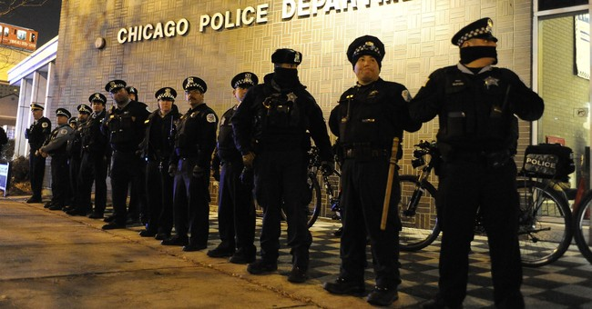 Holstered gun stops bullet fired at officer during deadly Chicago hospital shooting