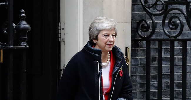 British PM delays Brexit deal vote but European Union warns no renegotiation