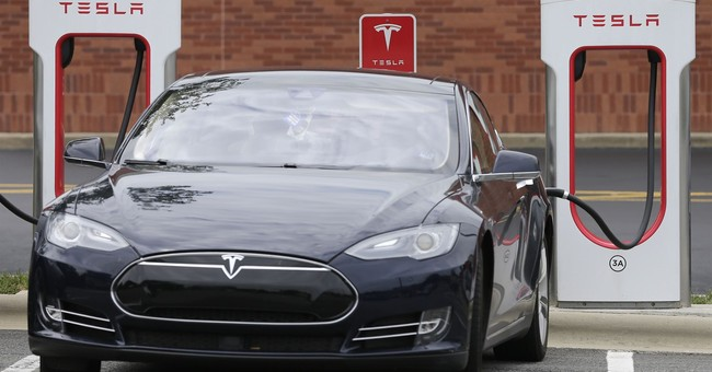 Tesla Stock Priced For Smooth Ride, Not Huge Potholes